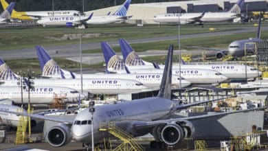 United Airlines planes parked at airport.