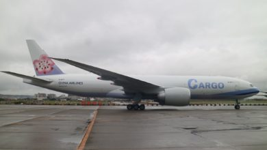 A side view of new China Airlines 777 on a gray day.
