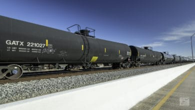 A photograph of tank cars parked at a rail yard.