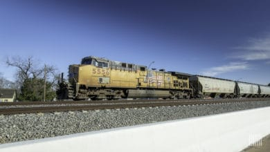 A photograph of a Union Pacific train traveling through a field.