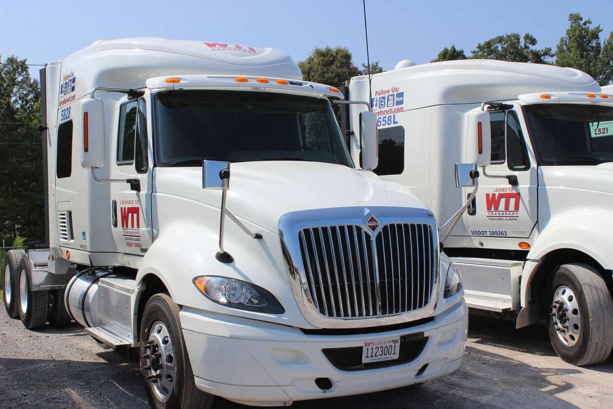 Two WTI Transport white tractors are ready for use. (Photo: WTI Transport)