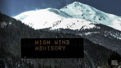 """High Wind Advisory"" digital sign along a mountain highway."
