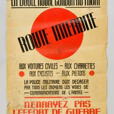 A sign printed in French warning that the Red Ball Express route was closed to all civilian traffic.  (Photo courtesy of the First Division Museum)