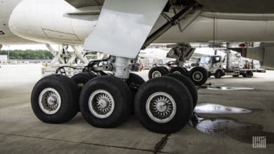 Close of landing gear on a large jet.