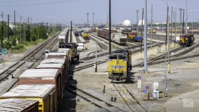 A photograph of rail cars parked in a rail yard.