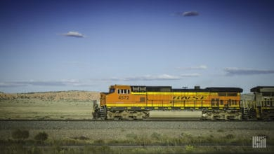 A photograph of a BNSF locomotive crossing a field.