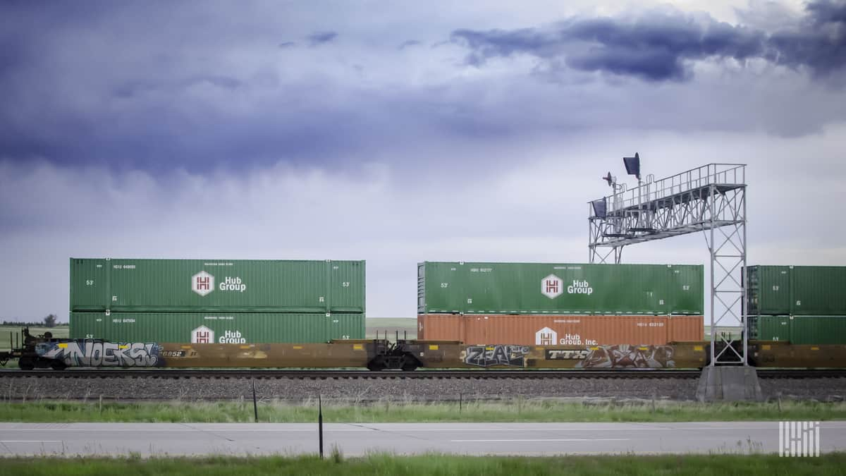 A photograph of intermodal containers belonging to the Hub Group.