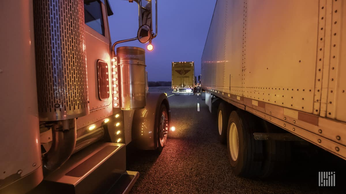 Tractor-trailers stuck in a traffic jam.