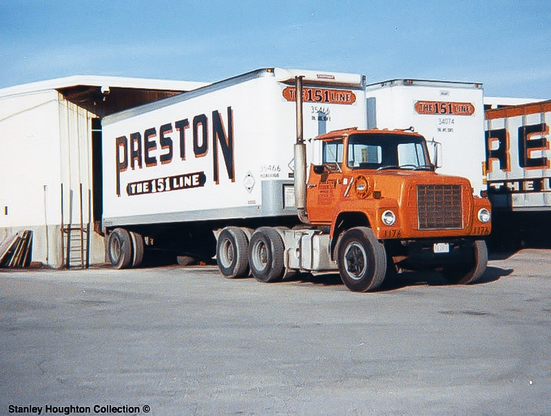 """Several Preston Trucking Co. trucks parked at the dock. """"The 151 Line"""" is displayed prominently.  (Photo: Stanley Houghton Collection)"""