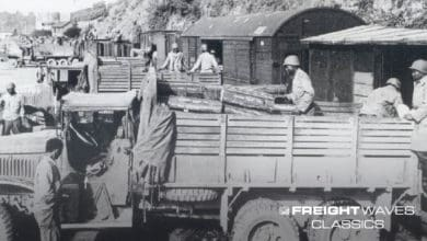 Red Ball Express trucks backed up to a train for supplies. (Photo courtesy of First Army Museum)