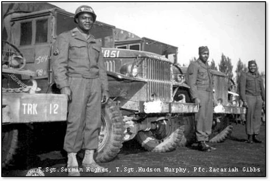 Members of the Red Ball Express in front of Red Ball trucks. (Photo courtesy of Logistics Officers Association)
