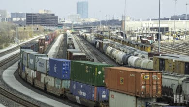 A photograph of intermodal containers parked at a rail yard.