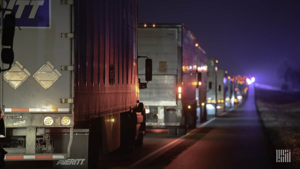 Tractor-trailers stuck in traffic on I-45 near Teague, Texas as road becomes icy on Feb. 13, 2021.