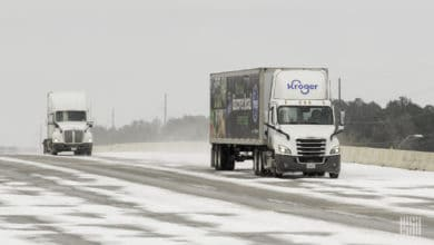 Tractor-trailers on a snow-covered Houston highway.