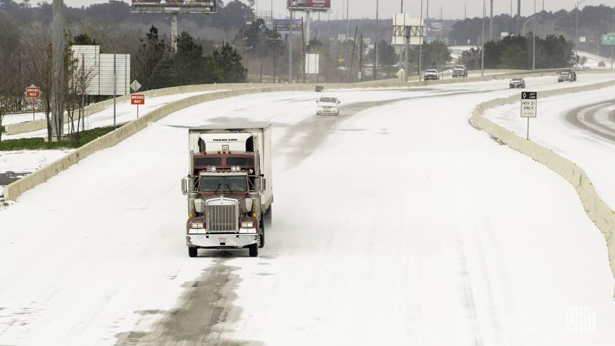 Tractor-trailer on snowy Houston, Texas road on Feb. 15, 2021.
