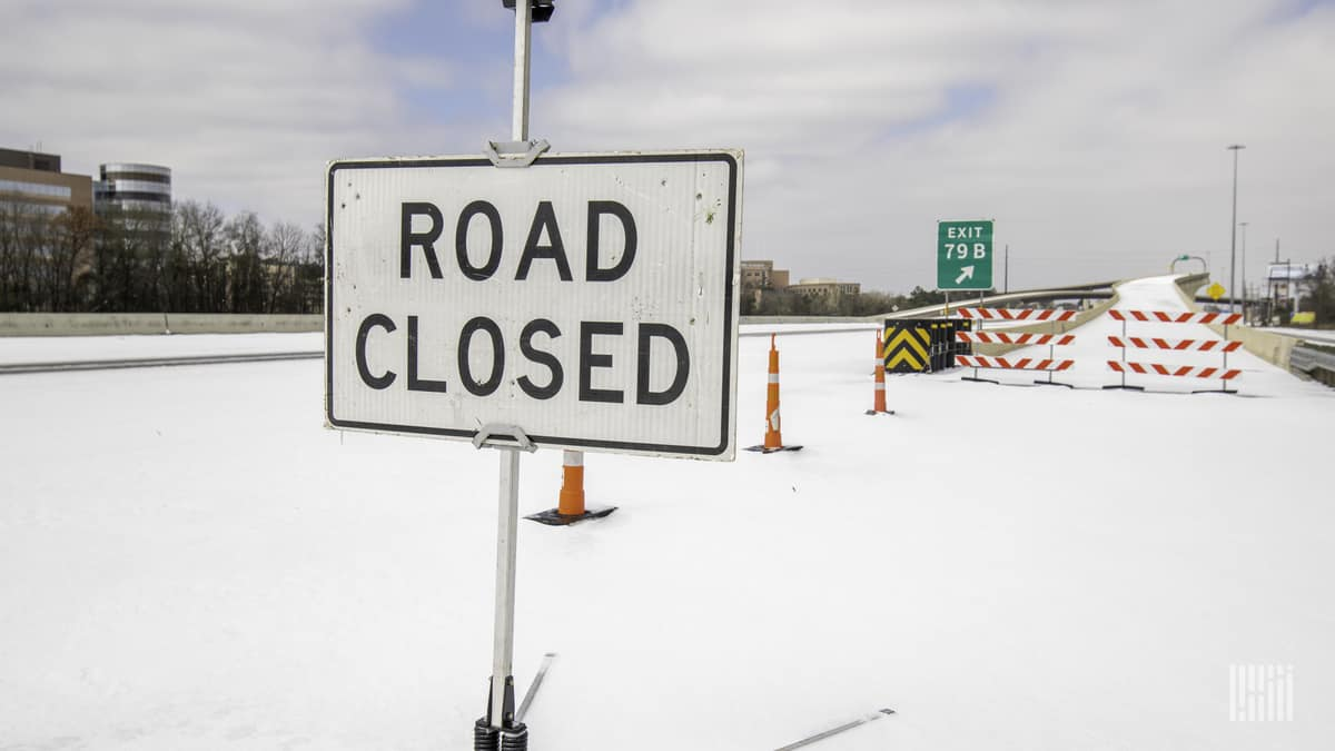 Closed I-45 north ramp in Conroe, Texas during snowstorm on Feb. 15,2021.