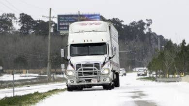 Tractor=trailer on snowy road in Texas, Feb. 15, 2021.