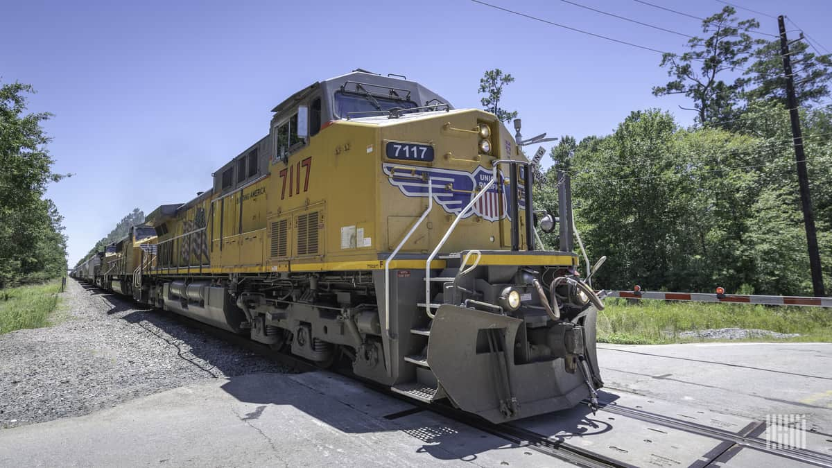 A photograph of a Union Pacific train at a rail crossing.