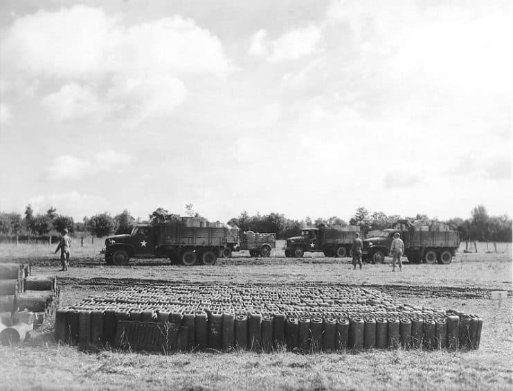 """In front of Red Ball Express trucks is a group of """"jerrycans"""" of gasoline - the lifeblood of the mechanized army.  (Photo courtesy of American Battle Monuments Commission)"""
