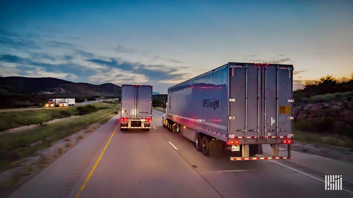Two tractor-trailers of UPS Freight. TFI International is acquiring UPS Freight.