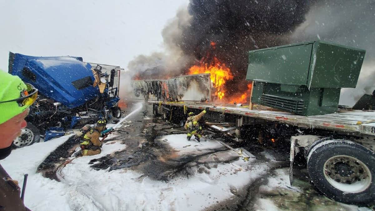A tractor-trailer burns in Oklahoma in the aftermath of a truck crash during a storm.
