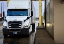 A tractor-trailer awaits inspection at the Fort Street Cargo Facility at the U.S.-Canada border in Detroit. A rookie trucker was arrested there after the discovery of marijuana in a trailer full of pork.