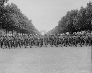 U.S. troops march through Paris, which had recently been liberated. (Photo: National Archives)