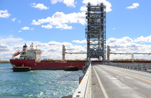 A ship passes through one of the bridges along the Seaway.  (Photo: Great Lakes St. Lawrence Seaway System)
