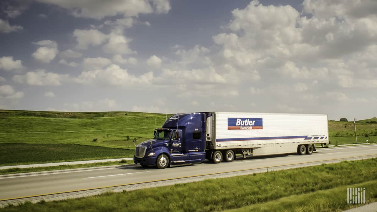 A Butler Transport rig passes green and rolling fields. (Photo: Jim Allen/FreightWaves)