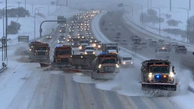 Traffic buildup behind snow plows on a Colorado highway.