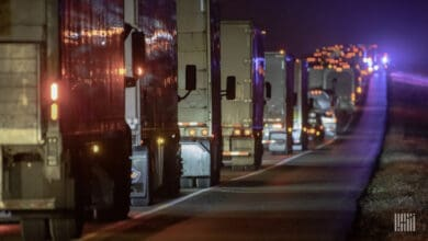 Trucks in highway traffic at night