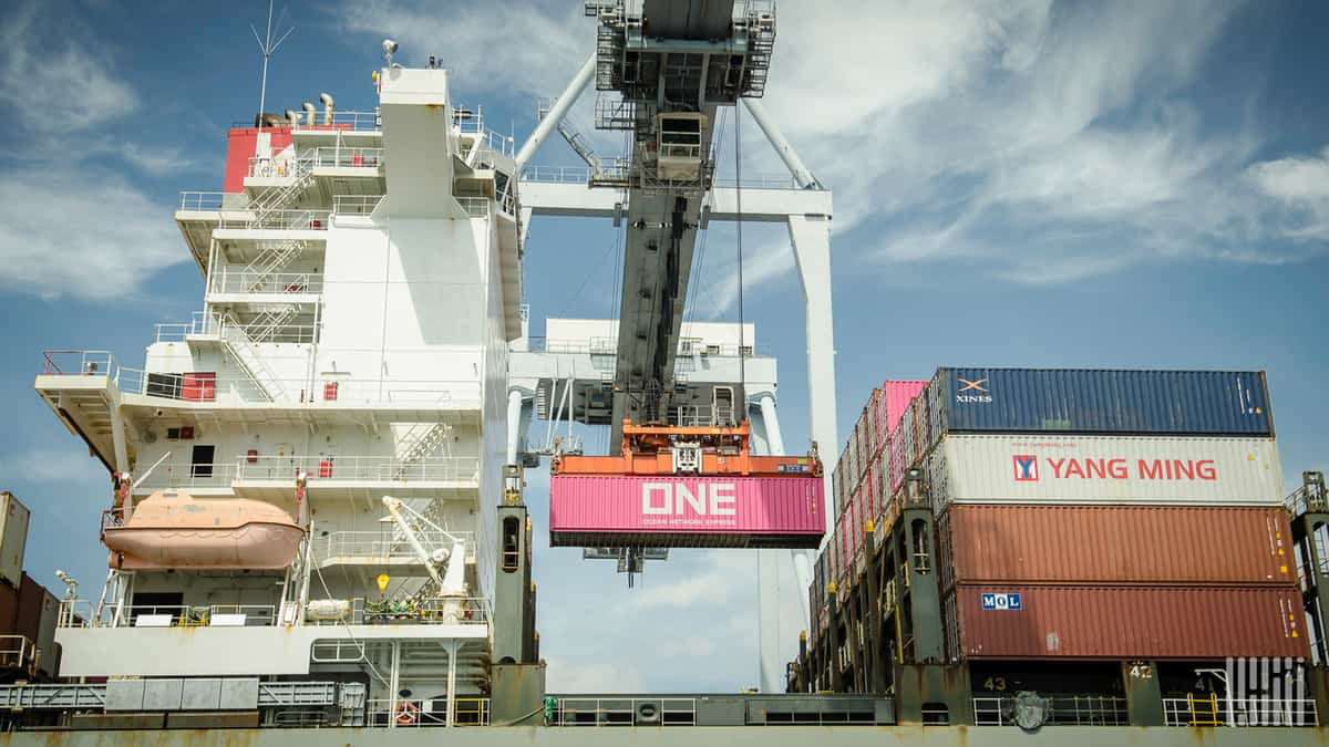 Containers being loaded onto a ship to illustrate the shipping firm ECU Worldwide being threatened with a data leak by hackers in a ransomware gang.