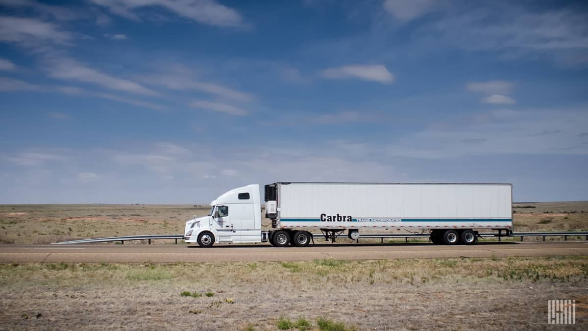 A Carbra Trans, Inc. truck moves across the prairie. (Photo: Jim Allen/FreightWaves)