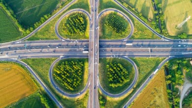 Rendering of a cloverleaf highway interchange with greenery.