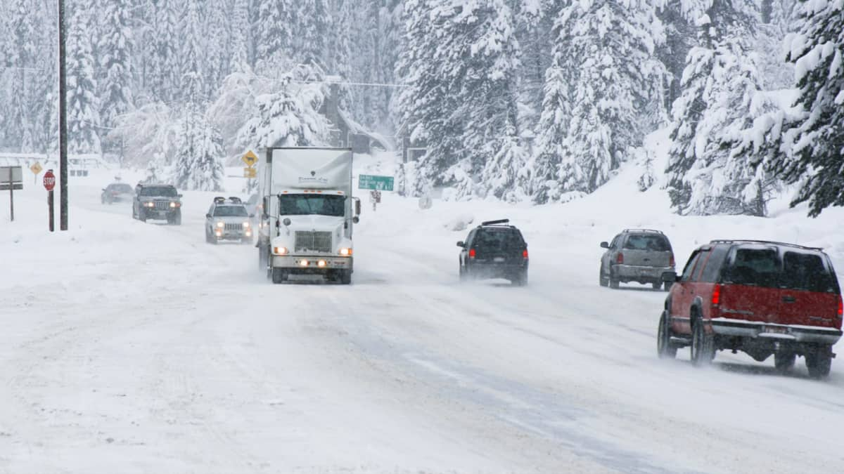 Cars and tractor-trailers on a snow covered Idaho highway.
