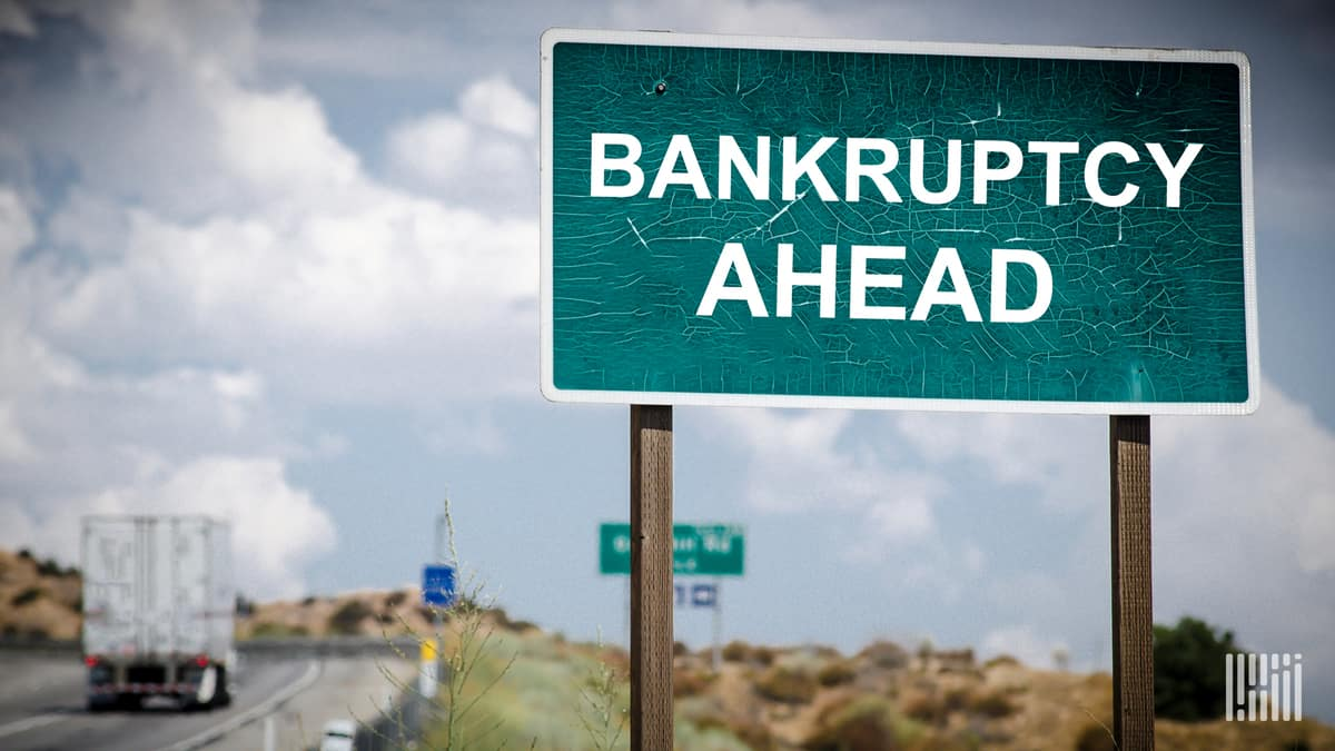 A road sign showing Bankruptcy Ahead to illustrate a story about a Michigan trucking company filing for Chapter 11 Bankruptcy.