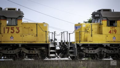 A photograph of two Union Pacific locomotives in a rail yard.