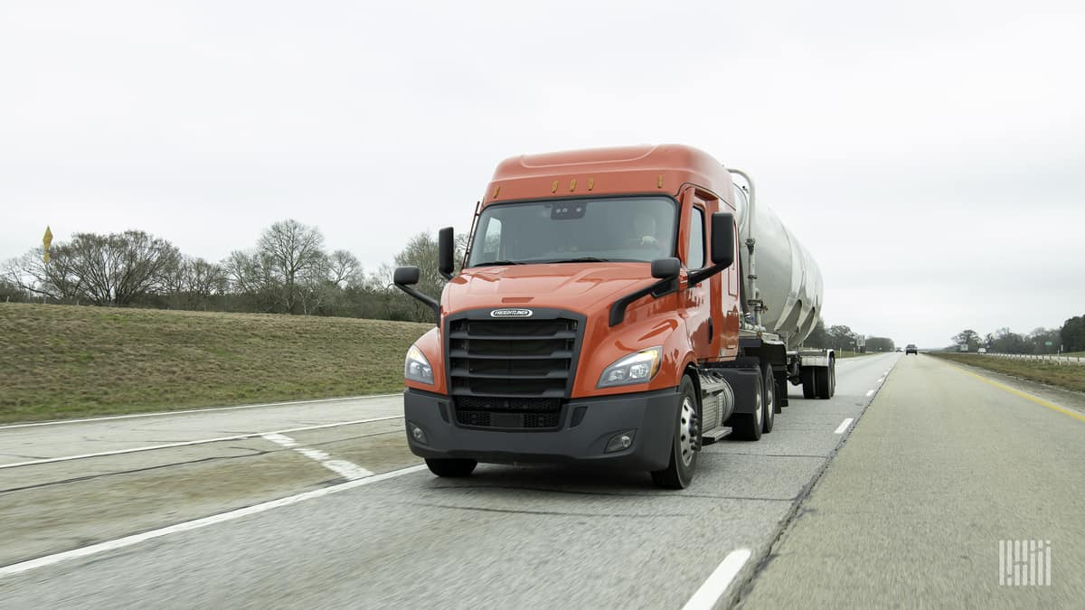 Tanker truck heading down a highway.