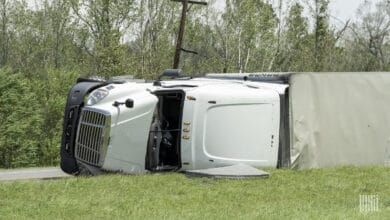 Tractor-trailer flipped on roadside.