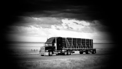 A tractor-trailer hauling oversized tires to illustrate an article about cargo theft.