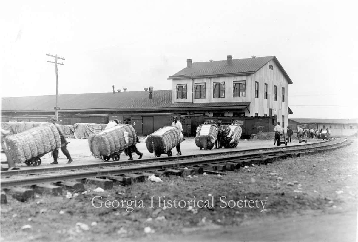 Moving bales of cotton along the railroad tracks. (Photo: Georgia Historical Society)