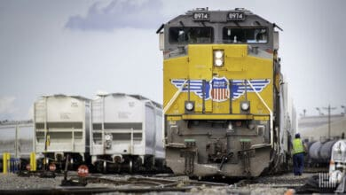 A photograph of a Union Pacific locomotive parked in a rail yard.