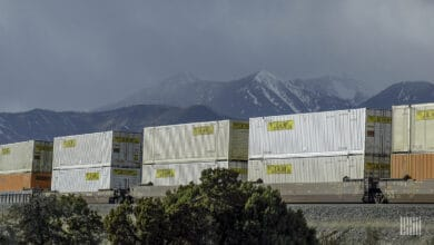 A photograph of a train hauling double stacked intermodal containers.