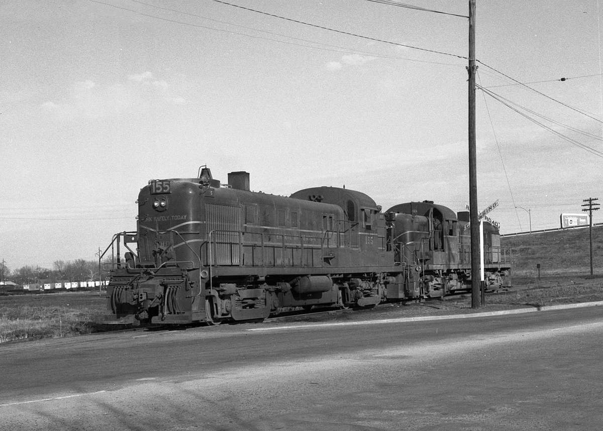 Central of Georgia locomotives run through a grade crossing at Augusta, Georgia in 1964.  (Photo: Bill McCoy photo/Warren Calloway collection)