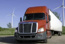 truck in front of windmills