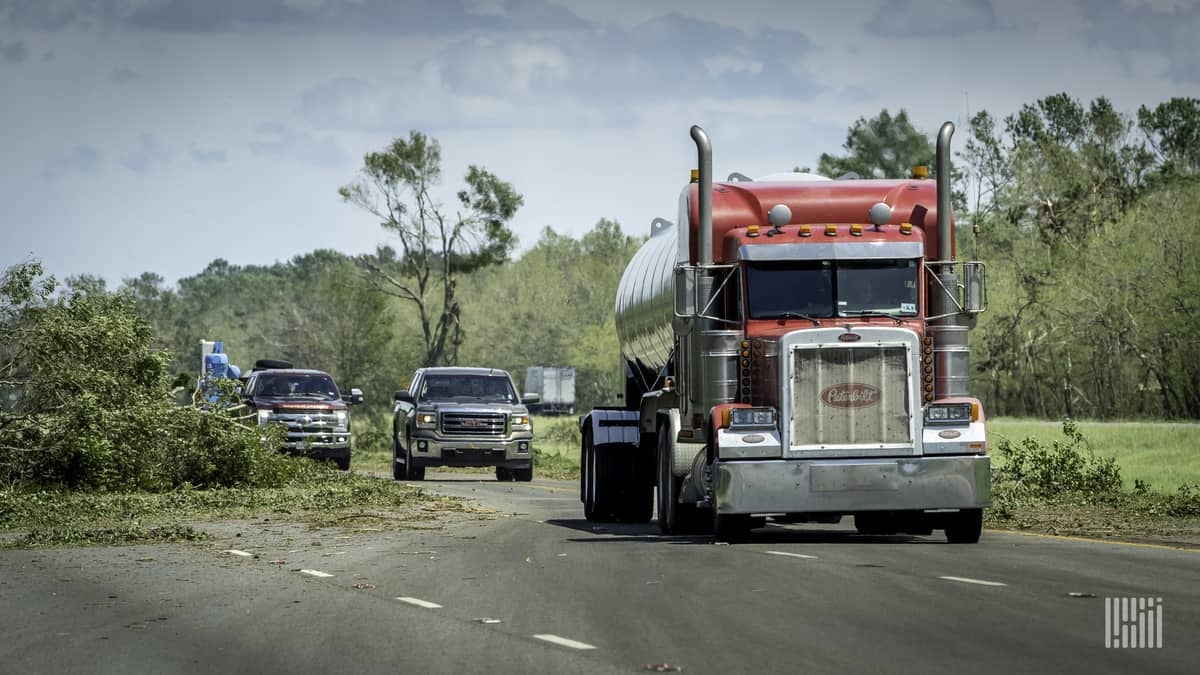 Trucker dodging downed trees and debris near Lake Charles, Louisiana after Hurricane Laura.