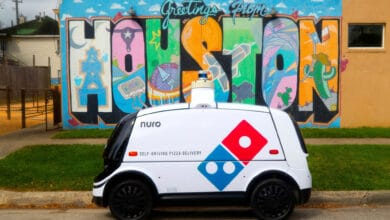 Nuro R2 self-driving robot delivering Domino's pizza in Houston