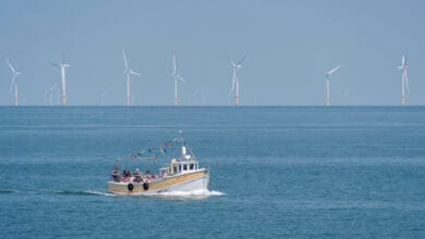 The Sea-Jay comes into dock at Llandudno, U.K., with the Ørsted Burbo Bank windfarm in the background.