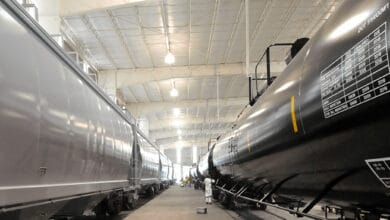 A photograph of two parked tank cars inside a building.