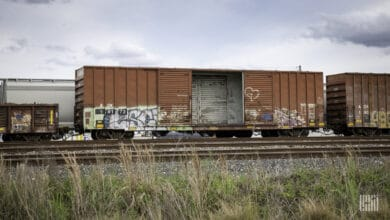 A photograph of an open box car.